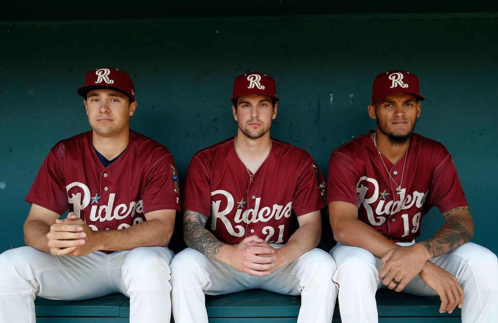 Frisco RoughRiders pitcher Brock Burke (23), Frisco RoughRiders pitcher Joe Palumbo (21) and Frisco RoughRiders pitcher Jonathan Hernandez (19) pose for a portrait during Frisco RoughRiders media day at Dr Pepper Ballpark in Frisco, Texas on Tuesday, April 2, 2019. (Vernon Bryant/The Dallas Morning News)