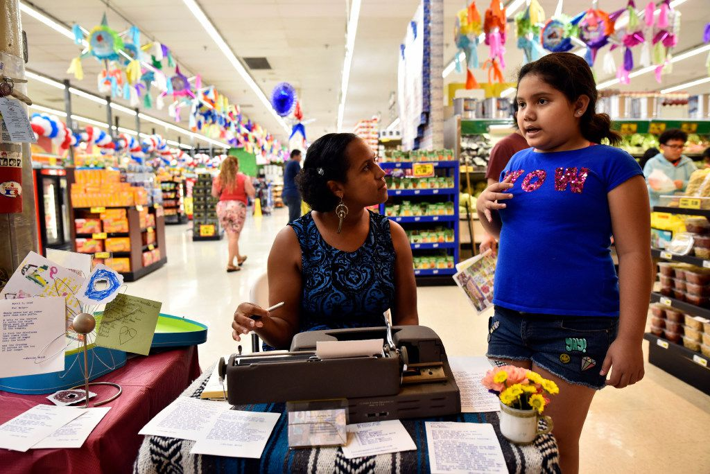 Typewriter poet Fatima-Ayan Malika Hirsi, 29, of Dallas visits with Alexa Rodriguez, 10, as they work together to write a poem about Alexa inside El Rancho supermarket in Pleasant Grove.