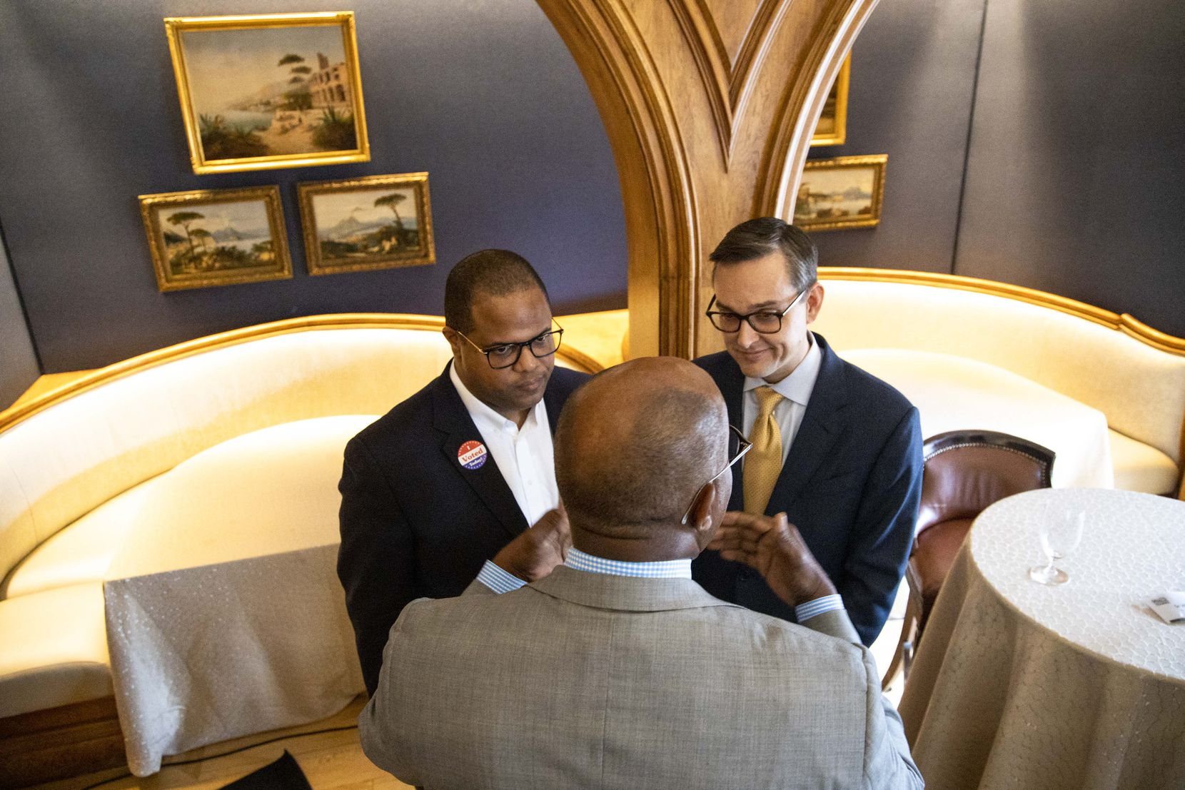 Mayoral candidates Eric Johnson and Scott Griggs chats with a member of the Dallas Citizen Council after their debate at The Crescent Club in Dallas on Tuesday, May 28, 2019.