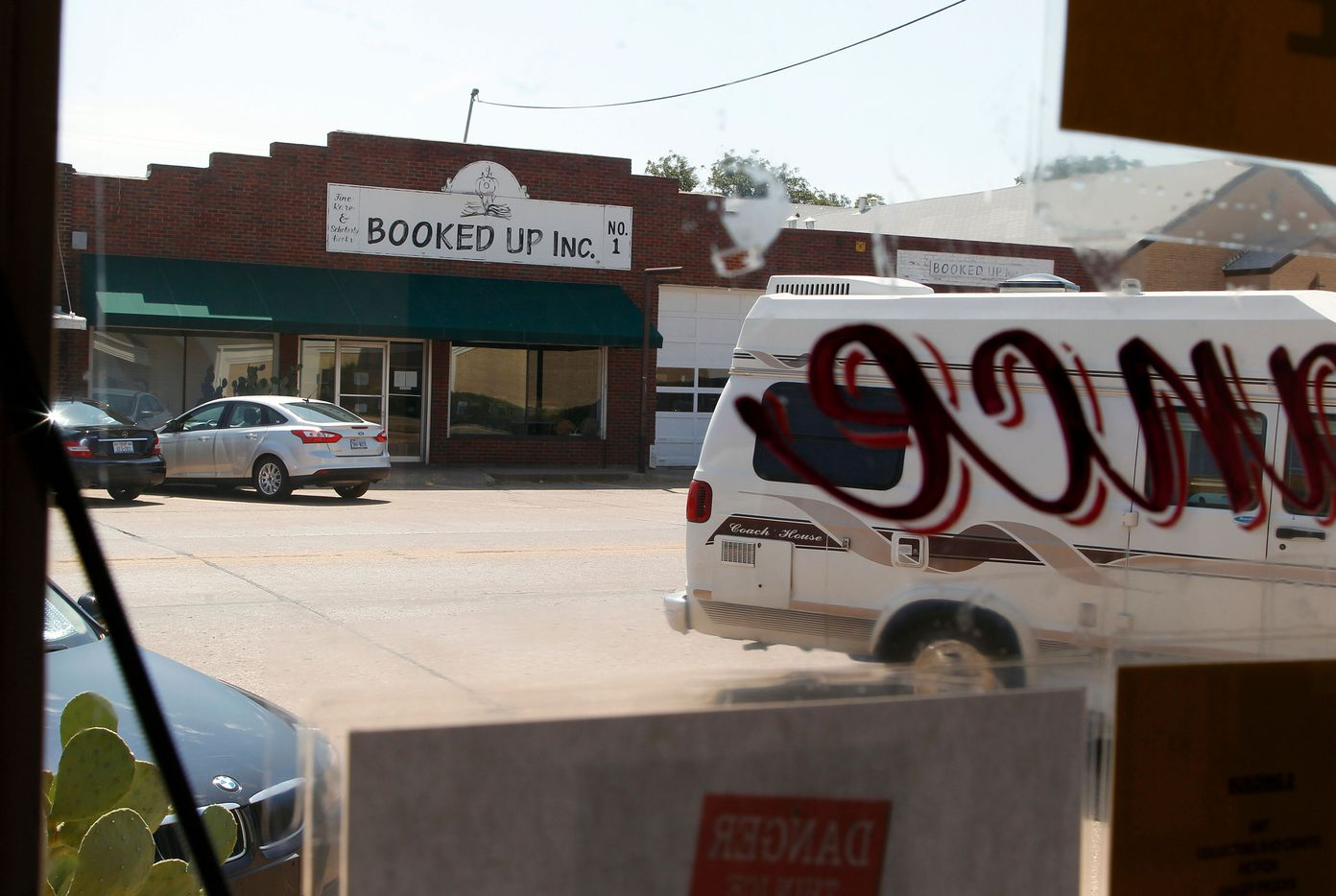 An August 2012 view from inside Booked Up Inc. #2, looking towards Booked Up Inc. #1 -- just two of the four bookstores owned by Larry McMurtry in downtown Archer City, TX. That year he sold off 200,000 books from his private collection, emptying out all but one of the storefronts.