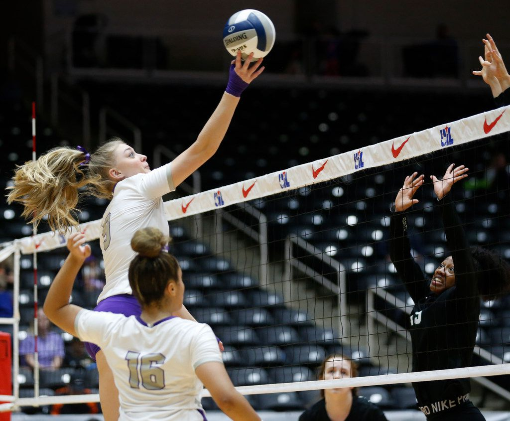 Lamar Fulshear's Skylar Voskuhl (9) hits the ball over Kennedale's Alexandra Youngblood (15) during the third set of a Class 4A volleyball state semifinal match at the Curtis Culwell Center in Garland, on Thursday, November 21, 2019. Fulshear won three straight sets 25-14, 25-11 and 25-20 to advance to the state final.