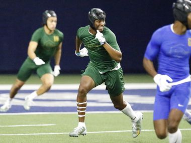 Jahari Rogers (center) of Arlington High School, plays defense during The Opening Finals, a football camp featuring some of the top high school recruits in the country. The final day of the event was held at The Star in Frisco on  Wednesday, July 3, 2019.