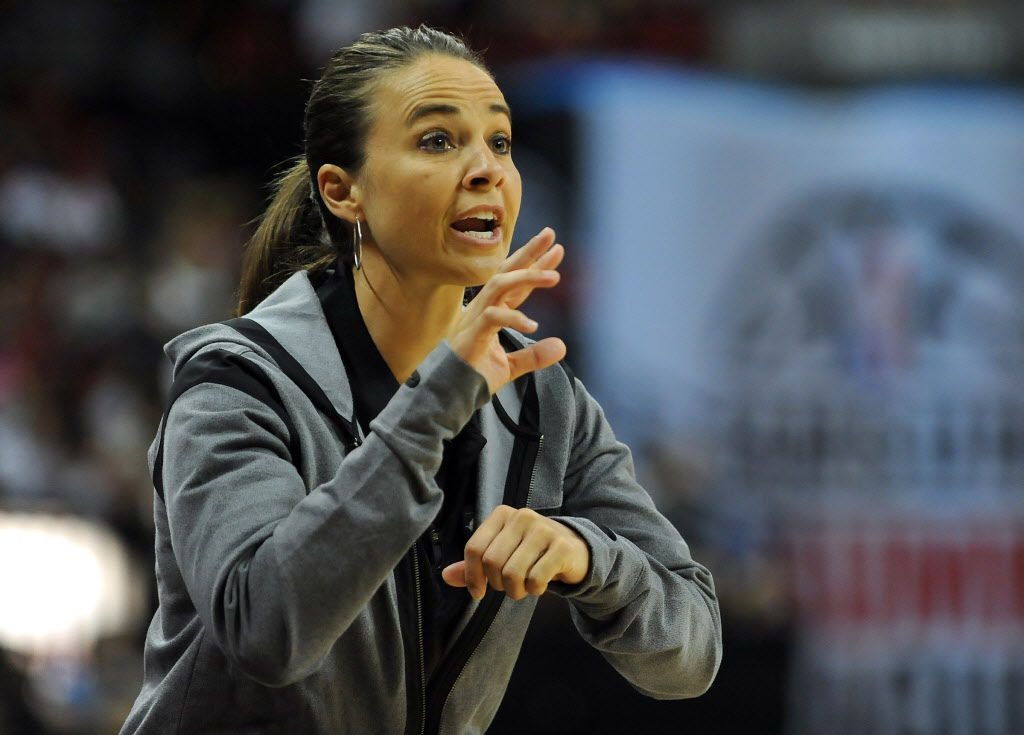 Coach Becky Hammon talks to a player on the floor during the NBA Summer League Final.