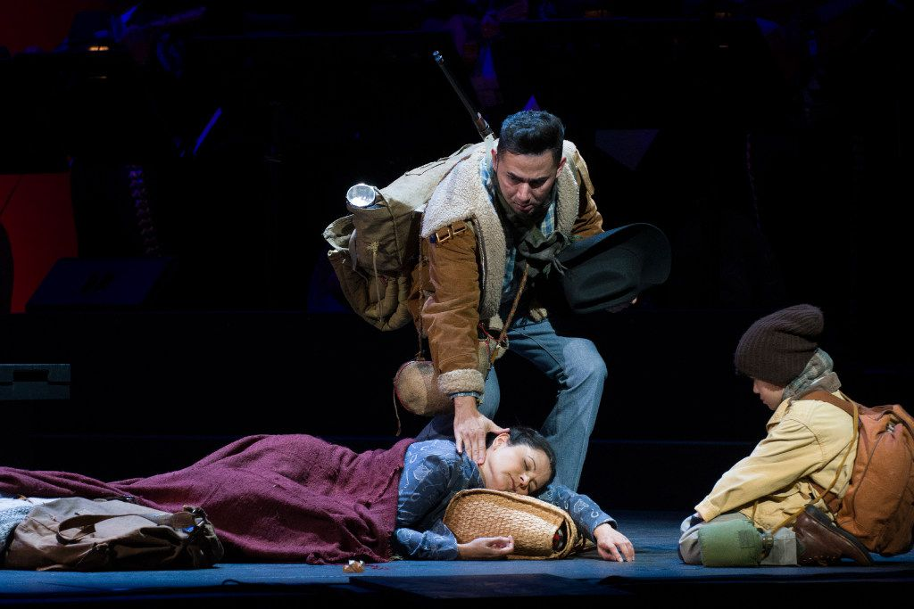 "Juan Mejia in the role of Victor, a coyote, touches the face of the dying Renata, portrayed by Cecilia Duarte, during the Fort Worth Opera's dress rehearsal of ""Cruzar la cara de la luna,"" on April 28, 2017 at Bass Performance Hall in Fort Worth, Texas. (Robert W. Hart/Special Contributor)"