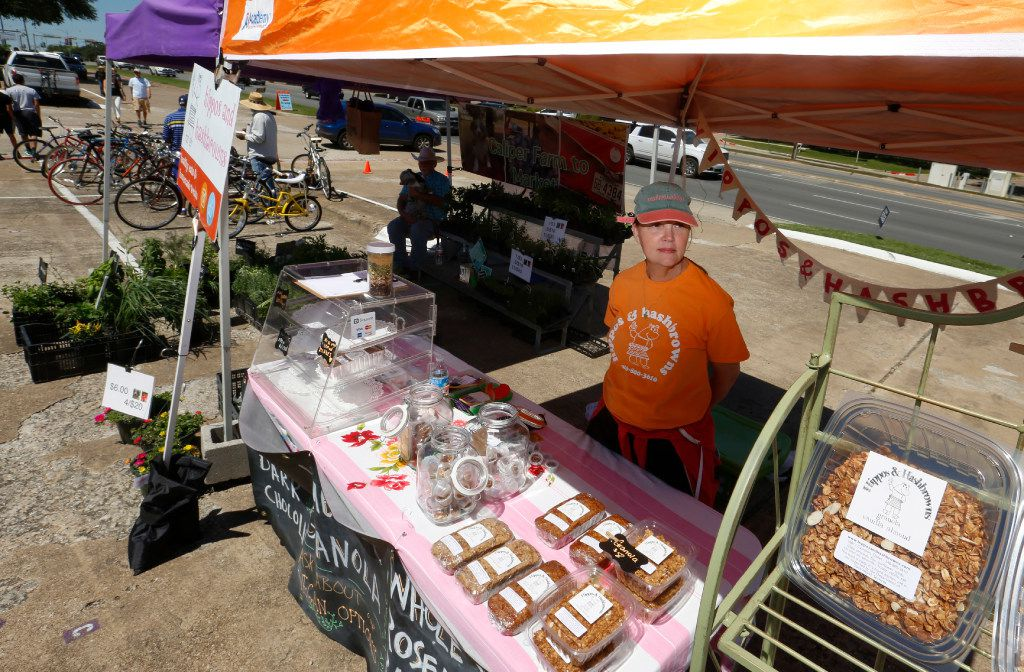 Sandra Daniels, at the Hippos and Hashbrowns booth at the White Rock Lake Farmers Market  waits for customers. She offers all natural whole grain crisps, tea breads and granola and by noon she was out of stock on most of her items.