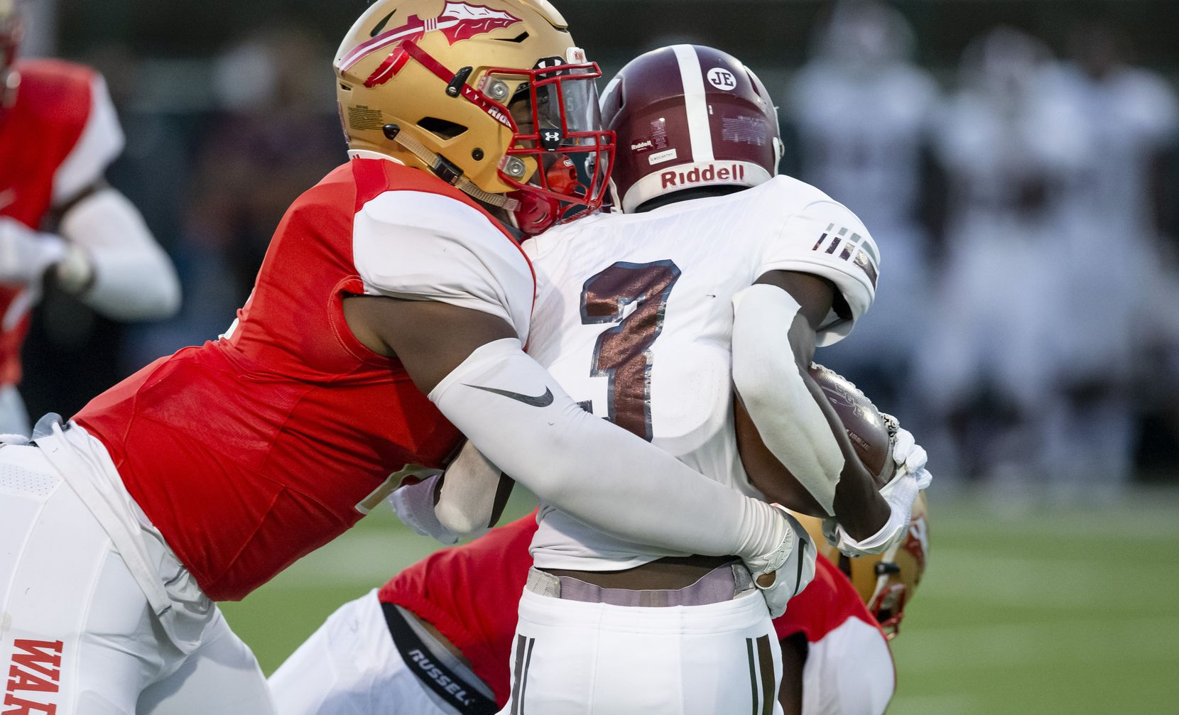 South Grand Prairie senior linebacker Marsel McDuffie (2), rights tackles Mesquite junior wide receiver Gervin McCarthy (3) during the first half of a high school football game at the Gopher-Warrior Bowl in Grand Prairie, Thursday, October 1, 2020. (Brandon Wade/Special Contributor)