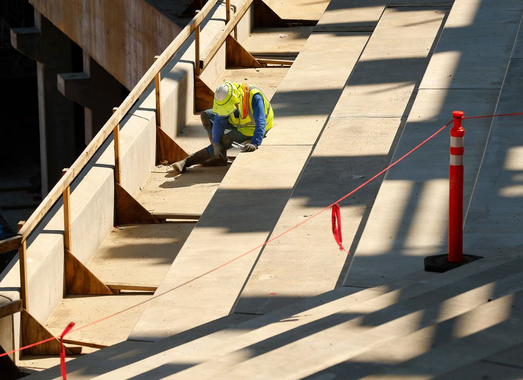 Hernando Castillo works on the main concourse seating area of the new Globe Life Field under construction in Arlington, Texas, Tuesday, September 18, 2018. The Texas Rangers celebrated the One Million Man Hours by providing a barbecue launch for its nearly 900 workers.