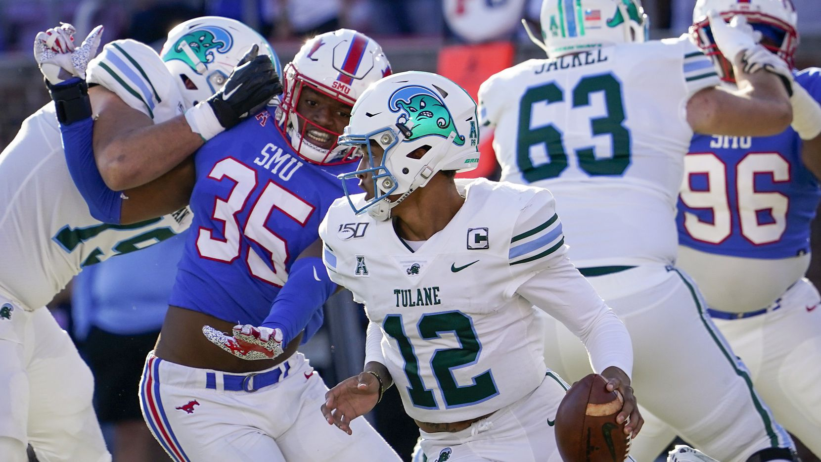FILE - Tulane quarterback Justin McMillan (12) scrambles away from SMU defensive end Delontae Scott (35) during the first half of a game at Ford Stadium on Saturday, Nov. 30, 2019, in Dallas.