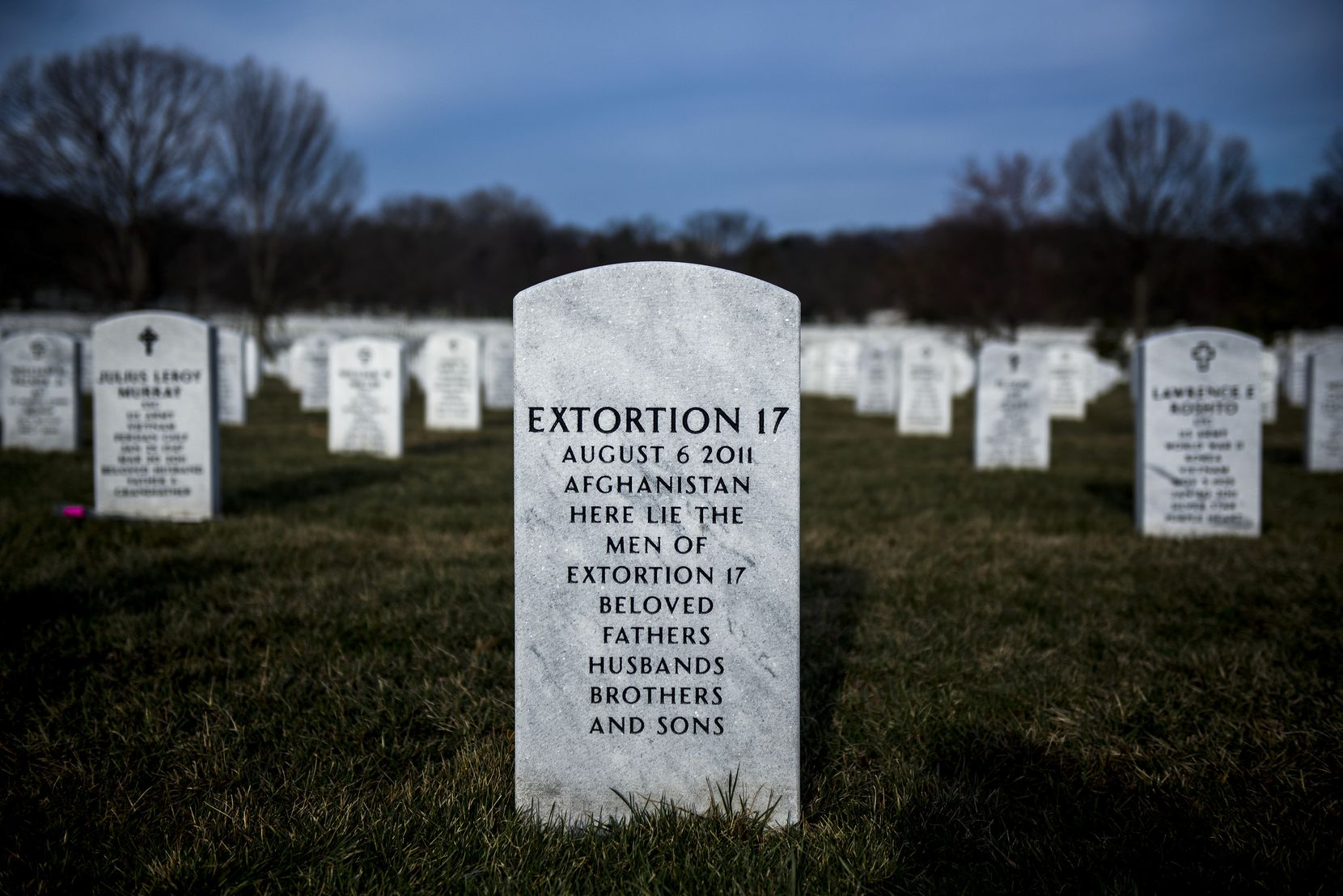 A grave for remains of Navy SEALs aboard a helicopter with the call sign Extortion 17, which crashed in 2011 in Afghanistan, at Arlington National Cemetery in Arlington, Va., March 22, 2015. The downing claimed 15 Gold Squadron members and two bomb specialists -- the most devastating day in the history of Navy SEAL Team 6.