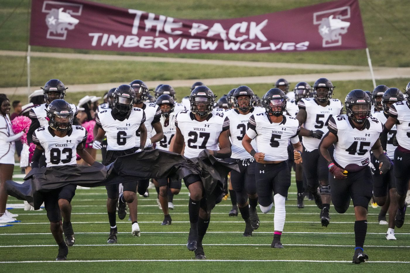 Mansfield Timberview take the field before facing Waco University in a high school football game at Waco ISD Stadium on Friday, Oct. 8, 2021, in Waco, Texas.