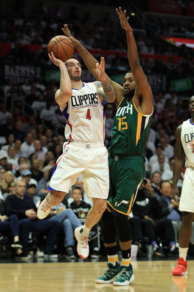 LOS ANGELES, CA - APRIL 25:  JJ Redick #4 of the Los Angeles Clippers shoots past the defense of Derrick Favors #15 of the Utah Jazz during the first half of Game Five of the Western Conference Quarterfinals at Staples Center at Staples Center on April 25, 2017 in Los Angeles, California.  NOTE TO USER: User expressly acknowledges and agrees that, by downloading and or using this photograph, User is consenting to the terms and conditions of the Getty Images License Agreement.  (Photo by Sean M. Haffey/Getty Images)