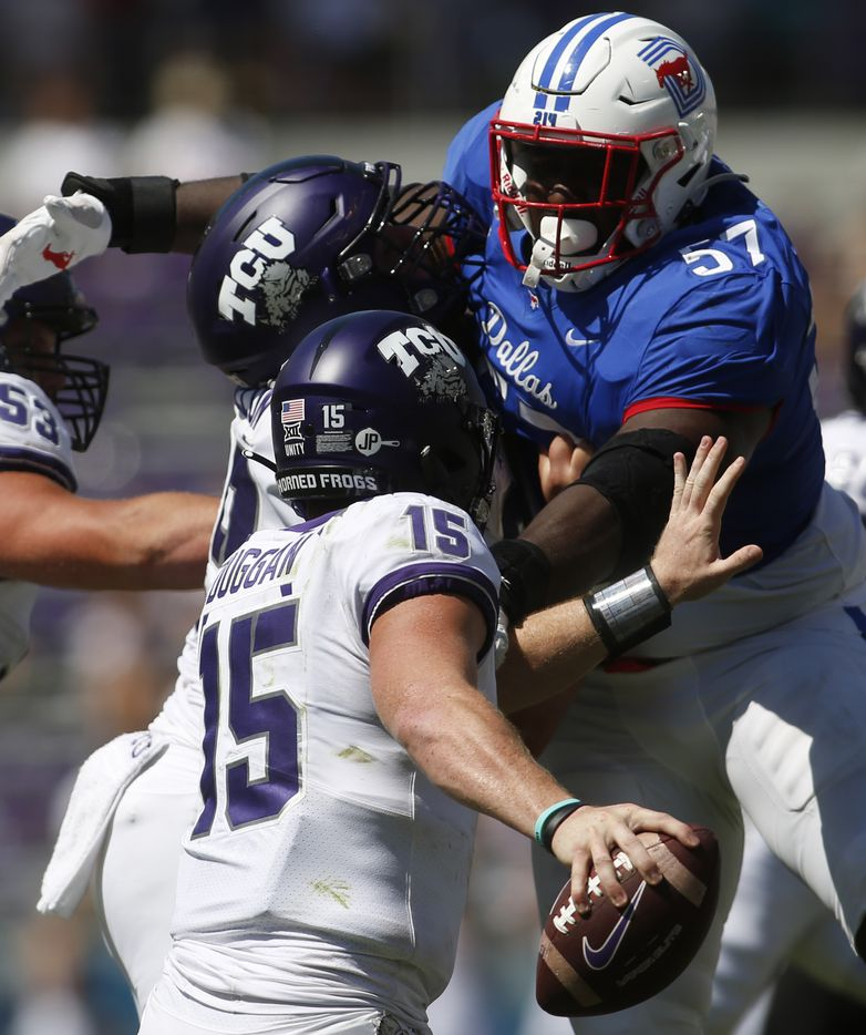 SMU defensive tackle Mike Williams (57) looms large as TCU quarterback Max Duggan (15) scrambles to avoid his rush during 4th quarter action. SMU won 42-34. The two teams played their NCAA football game at Amon G. Carter Stadium on the campus of TCU in Fort Worth on September 25, 2021. (Steve Hamm/ Special Contributor)