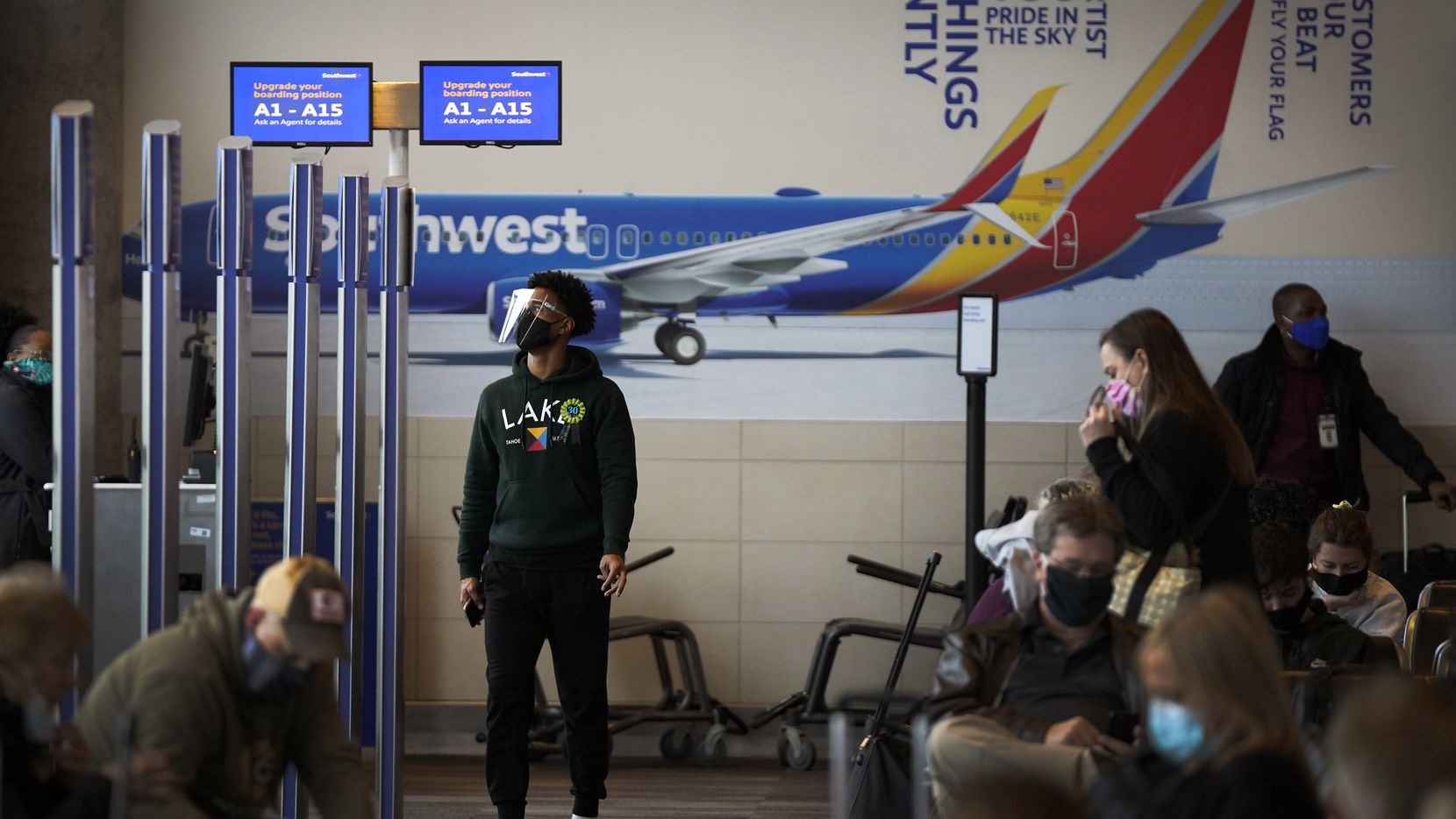 Passengers waited at Southwest Airlines gates inside the terminal at Dallas Love Field earlier this month.