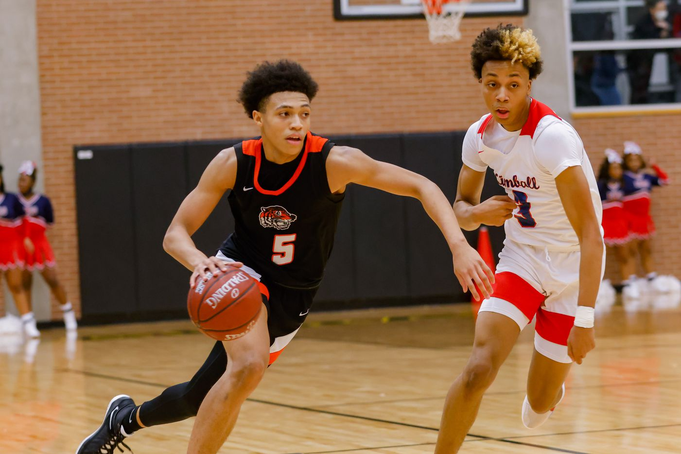 Lancaster's Elijah Hughey (5) drives past Kimball's Jayden Blair (0) during the first half of a boys basketball UIL Class 5A Region II playoff game in Forney on Friday, March 5, 2021. (Juan Figueroa/ The Dallas Morning News)