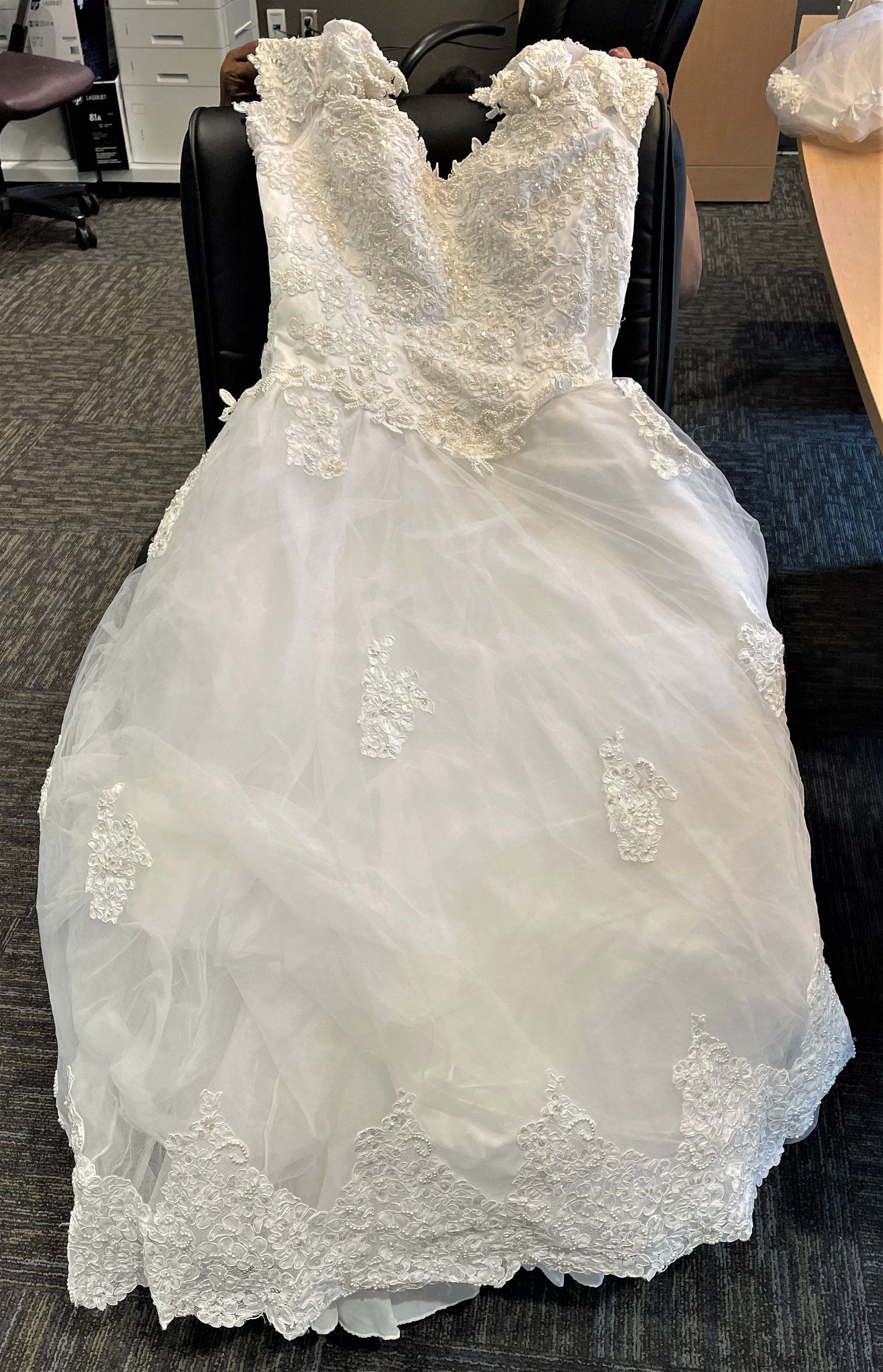 The North Texas Tollway Authority is trying to find the owner of this wedding dress, which an NTTA crew found in a box near the Dallas North Tollway and Gaylord Parkway in Frisco on Friday, July 23, 2021.