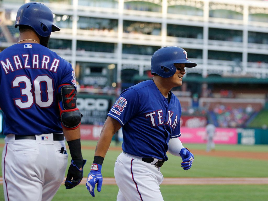 FILE - The Rangers' Shin-Soo Choo (17) smiles after Nomar Mazara (30) congratulated him for a home run in a game against the Kansas City Royals at Globe Life Park in Arlington on Thursday, May 30, 2019. (Vernon Bryant/The Dallas Morning News)