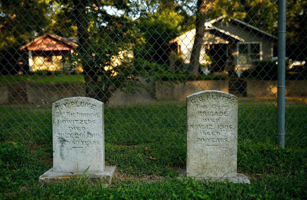 Military gravestones line the fence of the Confederate Cemetery located in the middle of a South Dallas neighborhood, Wednesday, August 23, 2017.