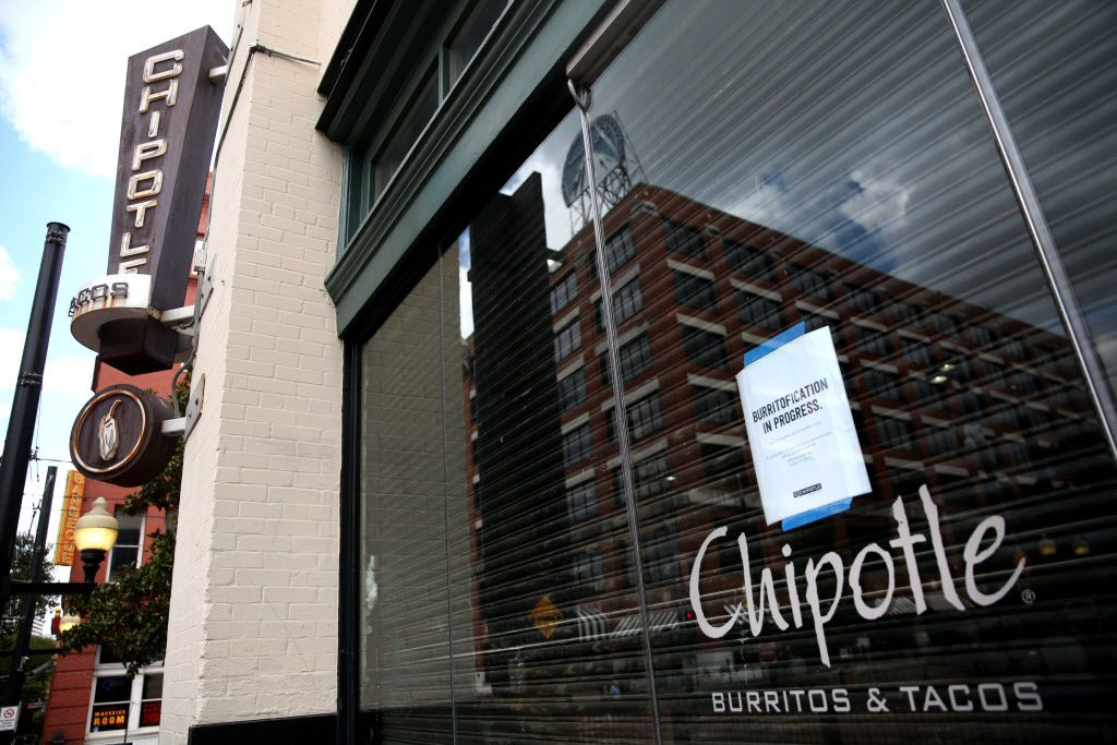 A closed for remodeling sign on the window of the Chipotle in the West End of Dallas on Wednesday.