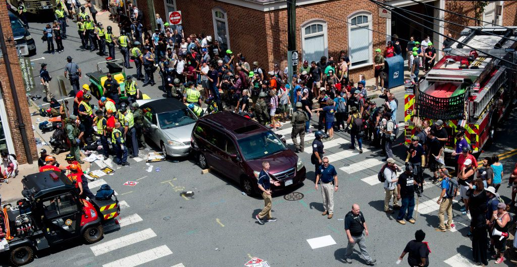 People receive first-aid after a car accident ran into a crowd of protesters in Charlottesville, VA on August 12, 2017.  A vehicle plowed into a crowd of people Saturday at a Virginia rally where violence erupted between white nationalist demonstrators and counter-protesters, witnesses said, causing an unclear number of injuries. / AFP PHOTO / PAUL J. RICHARDSPAUL J. RICHARDS/AFP/Getty Images