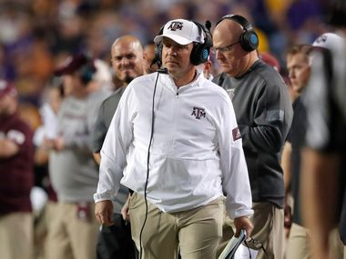 Texas A&M coach Jimbo Fisher walks along the sideline during the first half of the team's NCAA college football game against Texas A&M in Baton Rouge, La., Saturday, Nov. 30, 2019. LSU won 50-7.