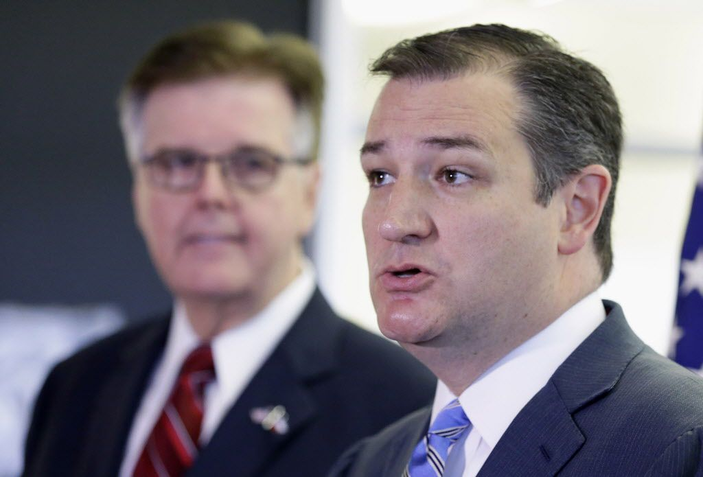 Texas Lt. Gov. Dan Patrick listens at left as Sen. Ted Cruz, R-Texas, speaks at a news conference Monday, Oct. 26, 2015, in Houston.