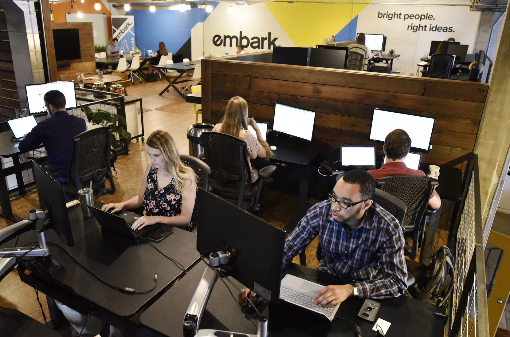 Embark manager Melissa Chastain, 25, left, and associate David Floyd, 25, are shown at the company's offices at Common Desk Deep Ellum in this October 2019 file photo.