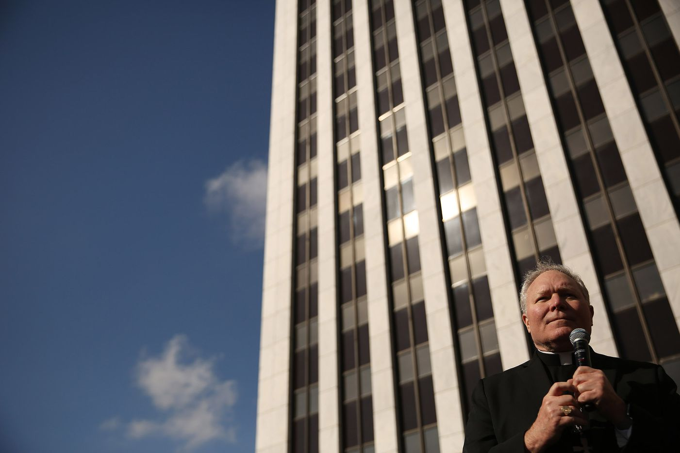 Bishop Edward J. Burns speaks ahead of anti-abortion activists in a parking lot adjacent to the Earle Cabell Federal Building at the rally portion of the North Texas March for Life in Dallas Saturday.