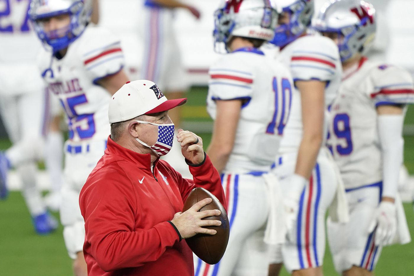 Austin Westlake head coach Todd Dodge watches his team warm up before the Class 6A Division I state football championship game against Southlake Carroll at AT&T Stadium on Saturday, Jan. 16, 2021, in Arlington, Texas.