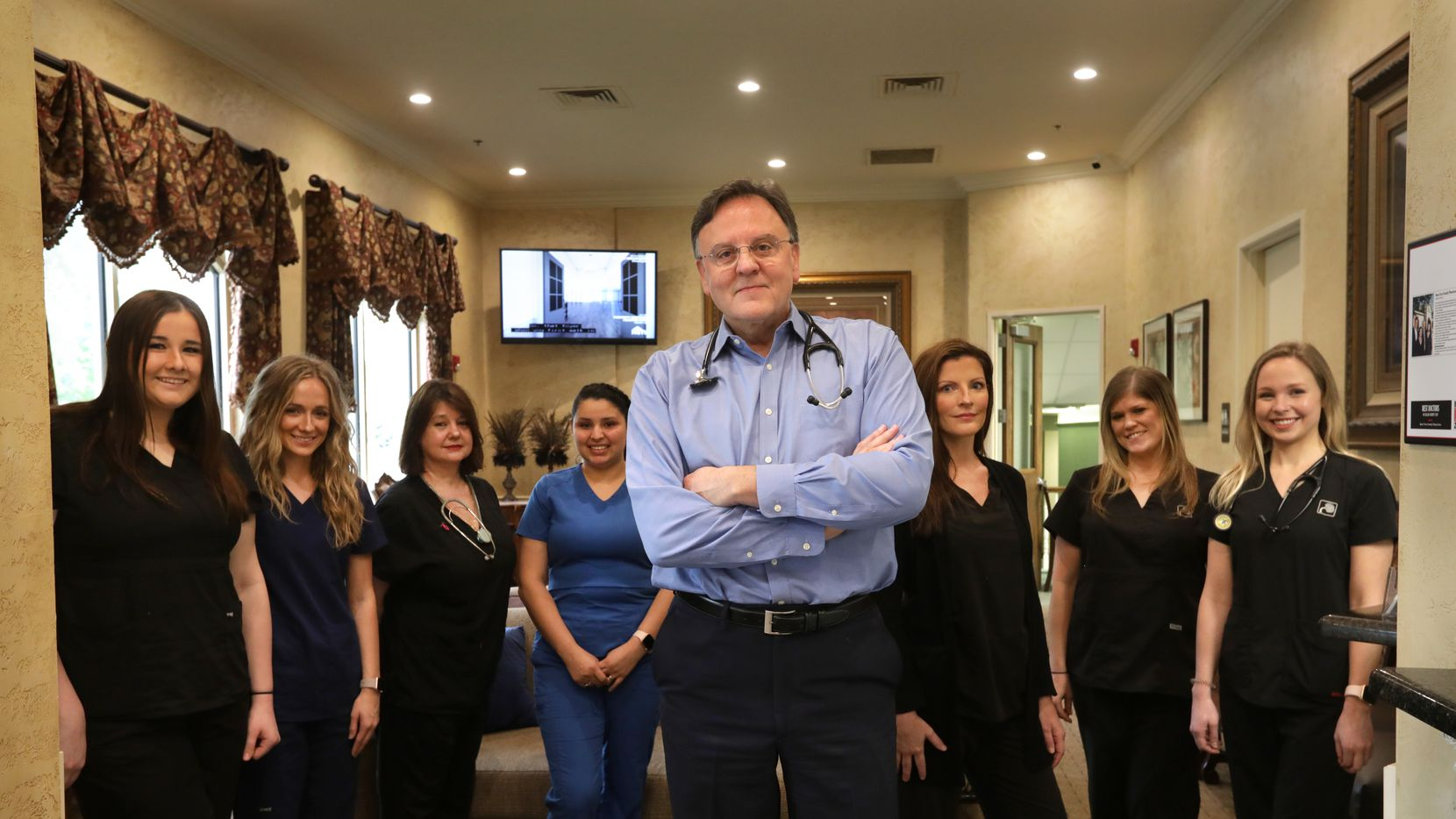 Dr. Guy Culpepper, seen here with some of his staff, has furloughed 70 employees at Bent Tree Family Physicians in Frisco and North Dallas. Revenue has fallen sharply during the coronavirus. (Jason Janik/Special Contributor)