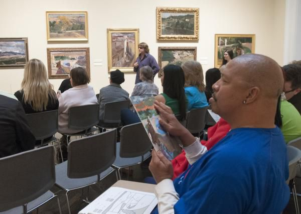 Bobby Jackson of Fort Worth runs his fingers over a small version of Joaquin Sorolla's The Blind Man of Toledo that mimics the texture of the actual canvas during a workshop at SMU's Meadows Museum.