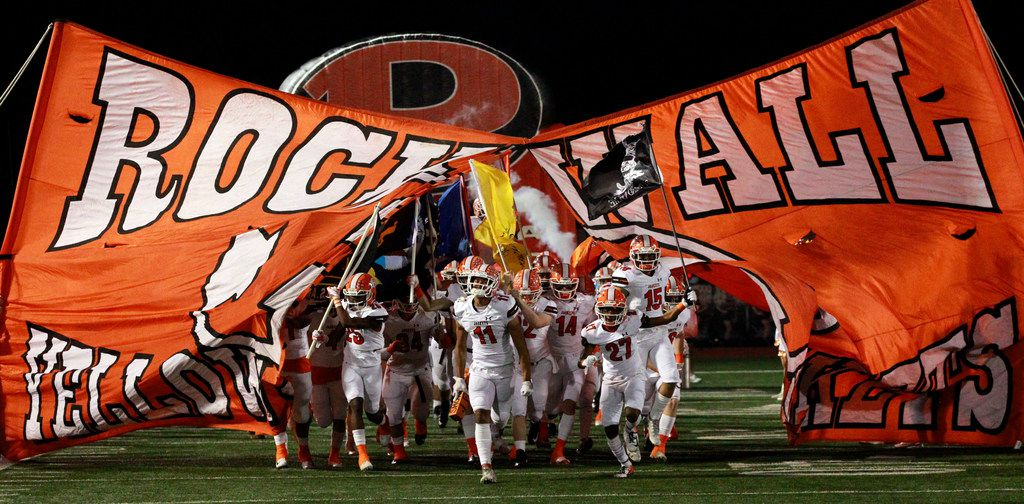 The Rockwall Yellowjackets take the field before the start of the the Class 6A Division I Region II area-round football playoff game against Allen at Williams Stadium in Garland on Friday, November 23, 2018. (John F. Rhodes / Special Contributor)