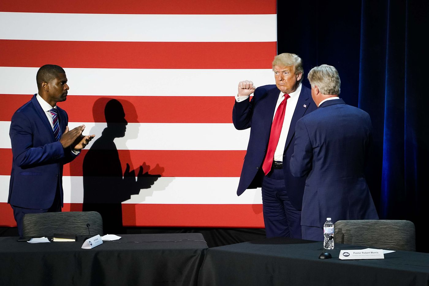 Jack Brewer (left) applauds as President Donald Trump acknowledges the crowd at the conclusion of a roundtable conversation about race relations and policing at Gateway Church Dallas Campus on Thursday, June 11, 2020, in Dallas. (Smiley N. Pool/The Dallas Morning News)