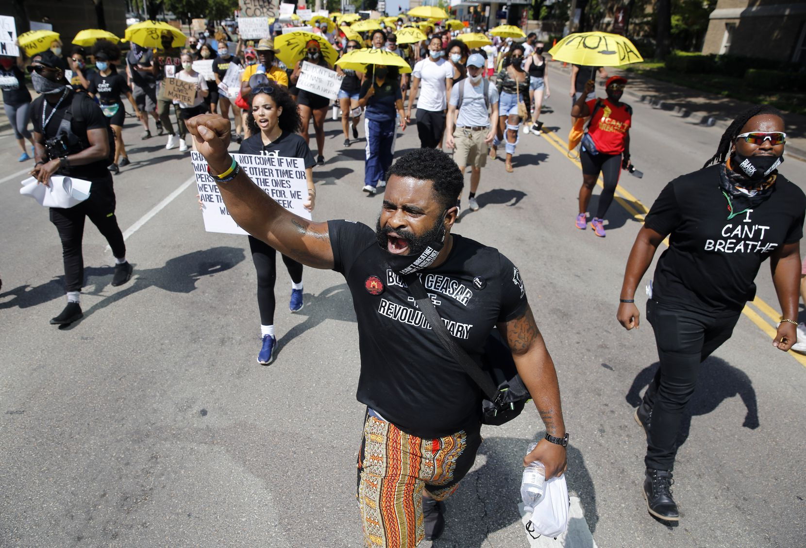 "Kristoddie Woods chants with protesters as they march on Ross Avenue in downtown Dallas during the ""Lead the Change"" Juneteenth rally."