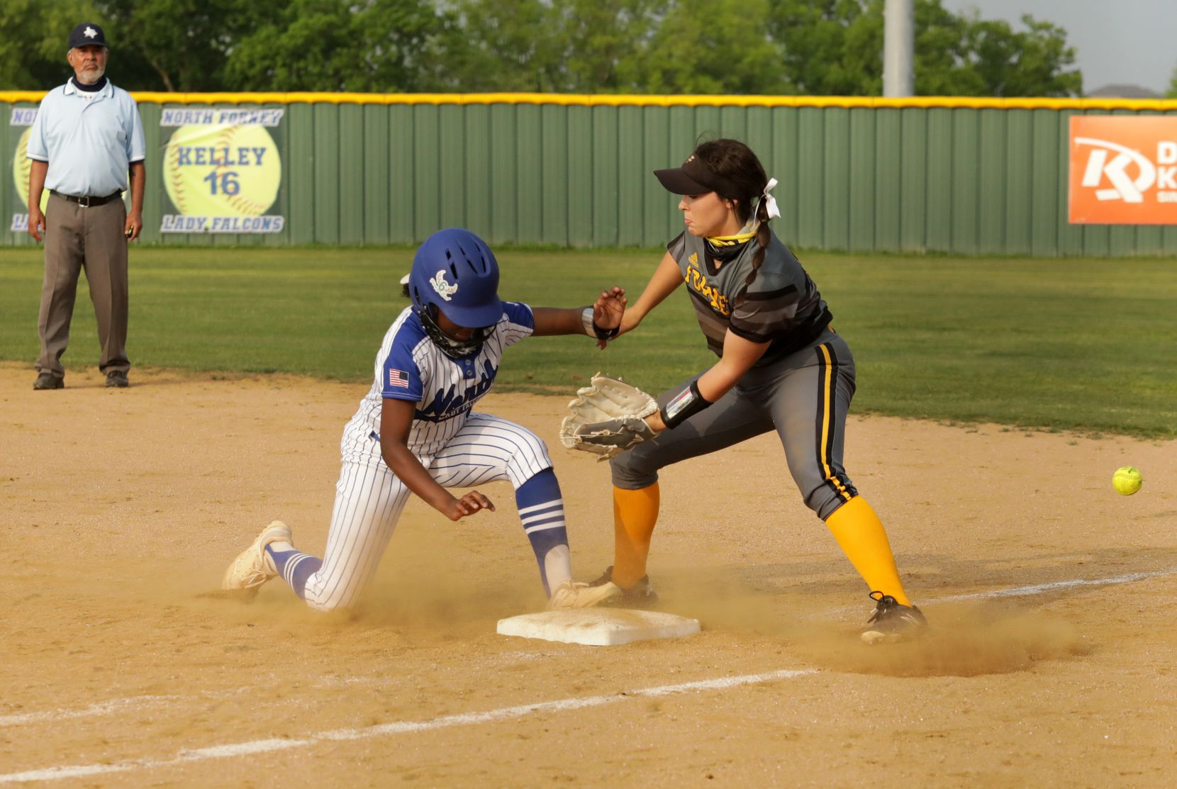 Hailey Hughes, left, attempts a return to first base against Savanna Hughes during a softball game between Forney at North Forney at North Forney High School in Forney, TX, on Apr. 9, 2021. (Jason Janik/Special Contributor)