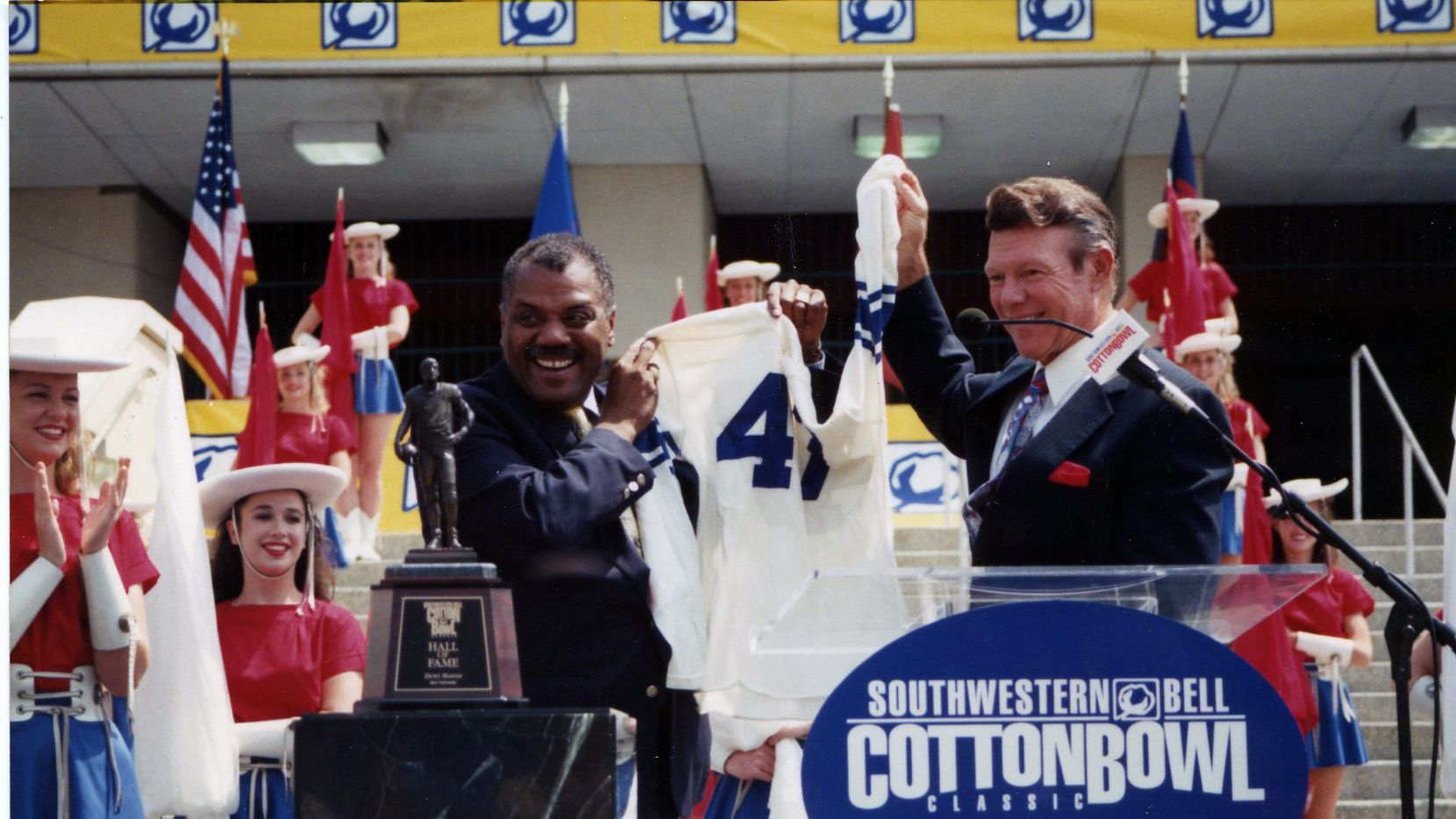 Two-time Cotton Bowl Chairman Fred McClure at the 1998 Cotton Bowl Hall of Fame Induction Ceremony with Rice running back Dicky Maegle.