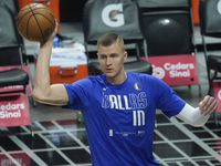 Dallas Mavericks center Kristaps Porzingis warms up before n NBA playoff basketball game against the LA Clippers at Staples Center on Tuesday, May 25, 2021, in Los Angeles.