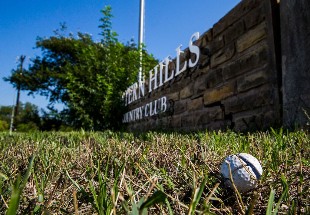 A broken golf ball lay near the entrance to Eastern Hills Country Club on Wednesday.