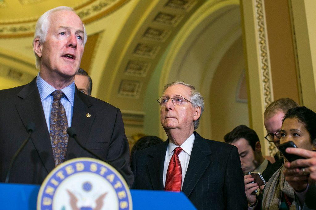 """Sen. John Cornyn (left) has expressed caution on the """"Buy American"""" push: """"It's a little more complicated than a bumper sticker."""" (Al Drago/The New York Times)"""