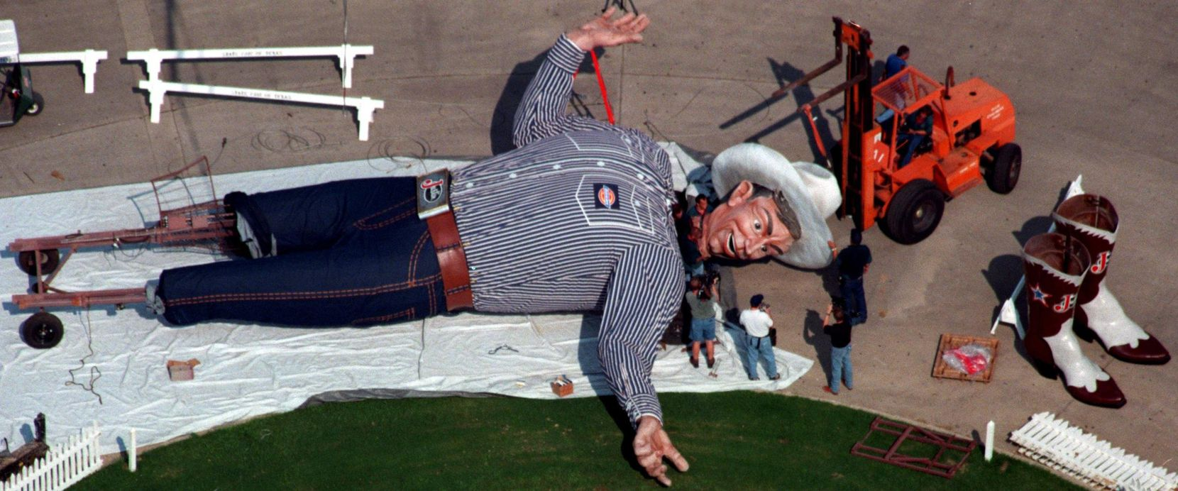 Sept. 21, 1998: Workers attach the head of Big Tex, the world's only 52-foot-tall talking and waving cowboy.