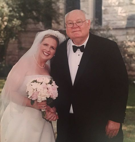 The author, Anna Hanks, poses with her father Milton Hanks on her wedding day.