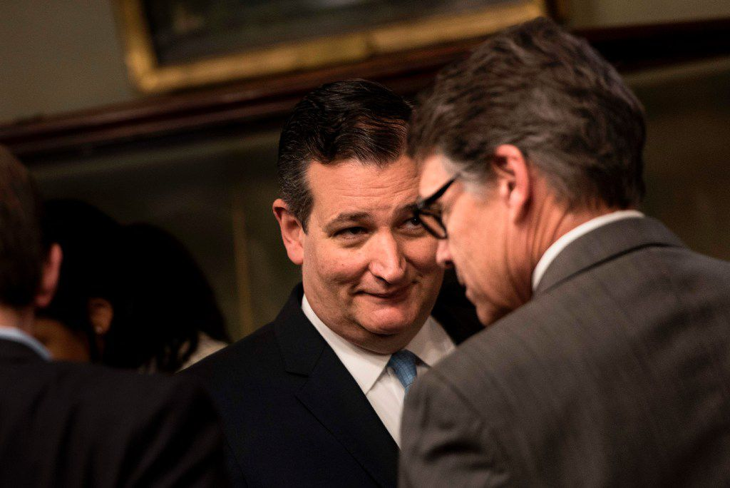 Sen. Ted Cruz and US Secretary of Energy Rick Perry wait for a swearing in ceremony in the Eisenhower Executive Office Building. (AFP PHOTO/Brendan Smialowski)