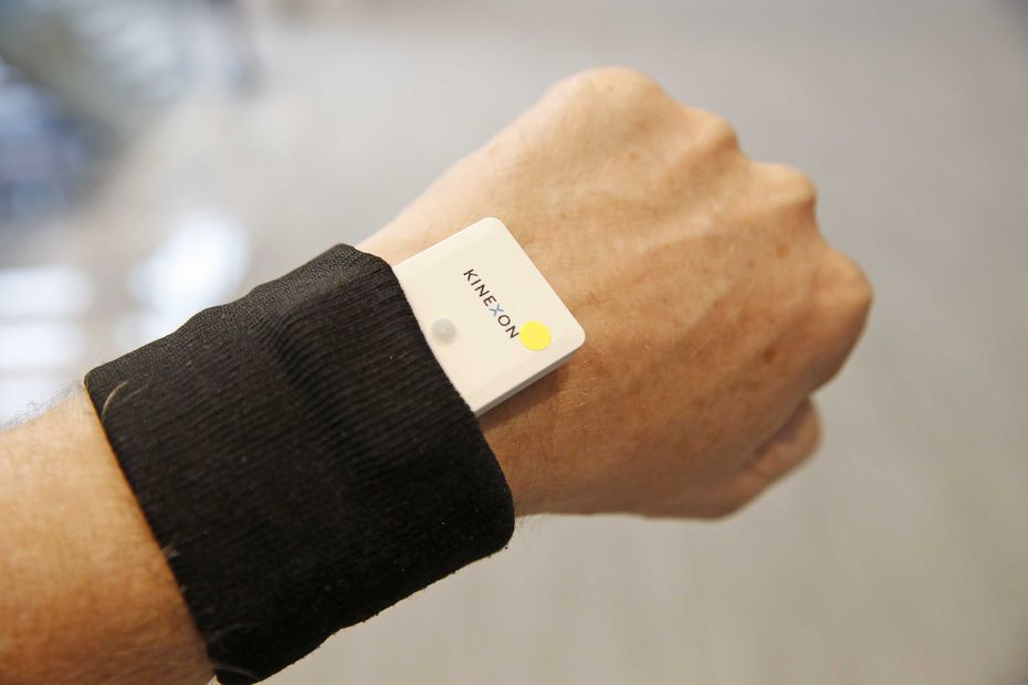 A contact tracking device is worn on the wrist. It monitors movements throughout the day and lets the wearer know if they are within six feet of another person for more than a few seconds.