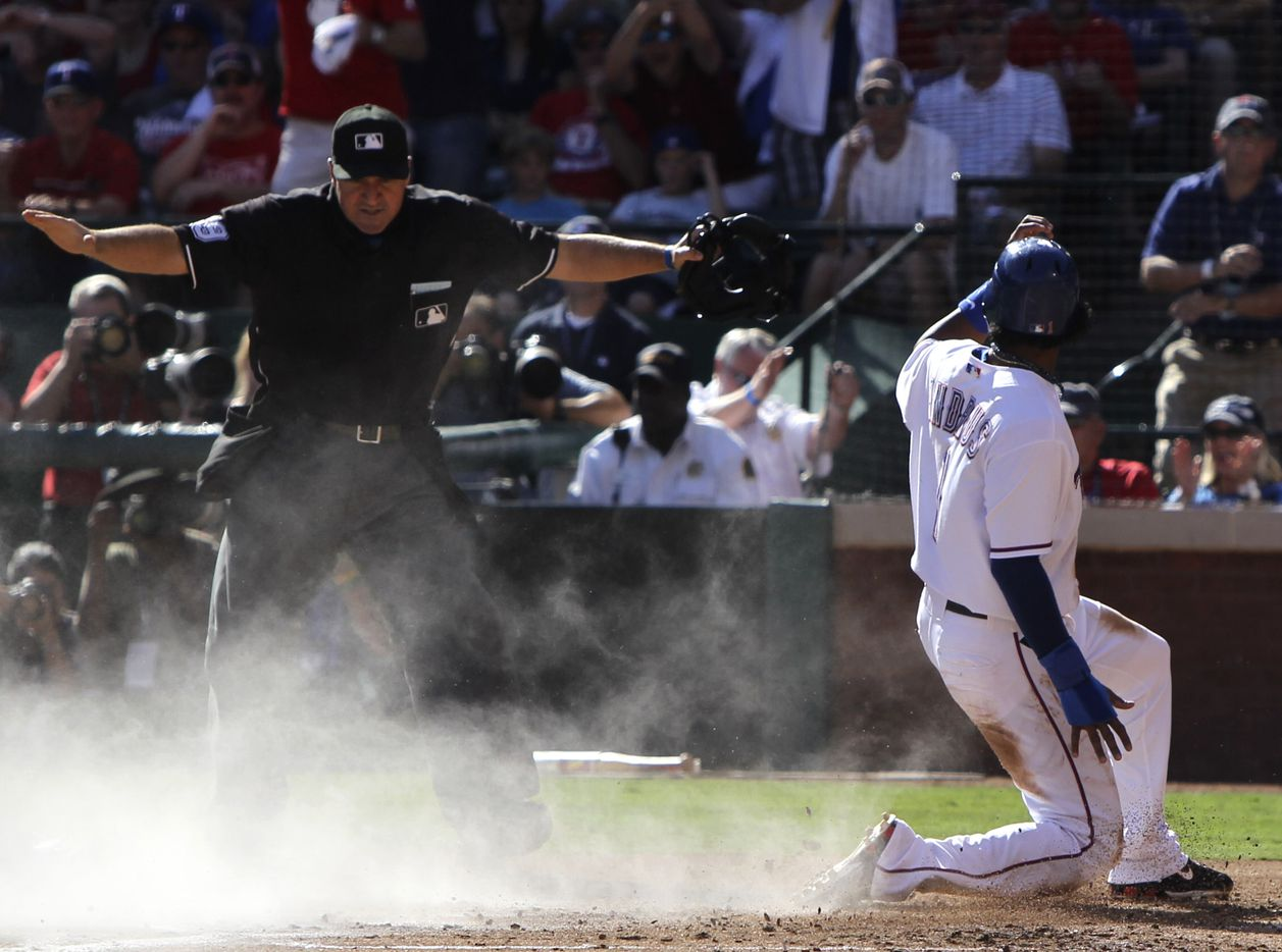 Umpire Terry Randazzo makes the call as Texas Rangers Elvis Andrus steals home on a double steal against the New York Yankees in the first inning during ALCS game two on Saturday October 16, 2010, at the Rangers Ballpark in Arlington. (Louis DeLuca/The Dallas Morning News)
