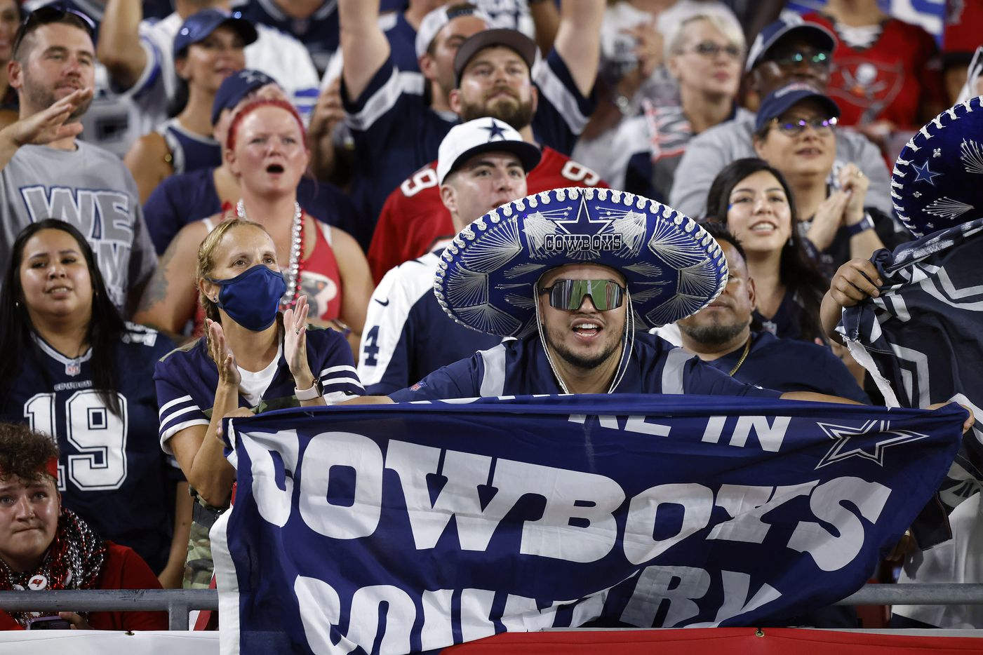 Dallas Cowboys fans celebrate a score in the first half against the Tampa Bay Buccaneers at Raymond James Stadium in Tampa, Florida, Thursday, September 9, 2021. The Cowboys faced the Tampa Bay Buccaneers in the NFL season opener. (Tom Fox/The Dallas Morning News)