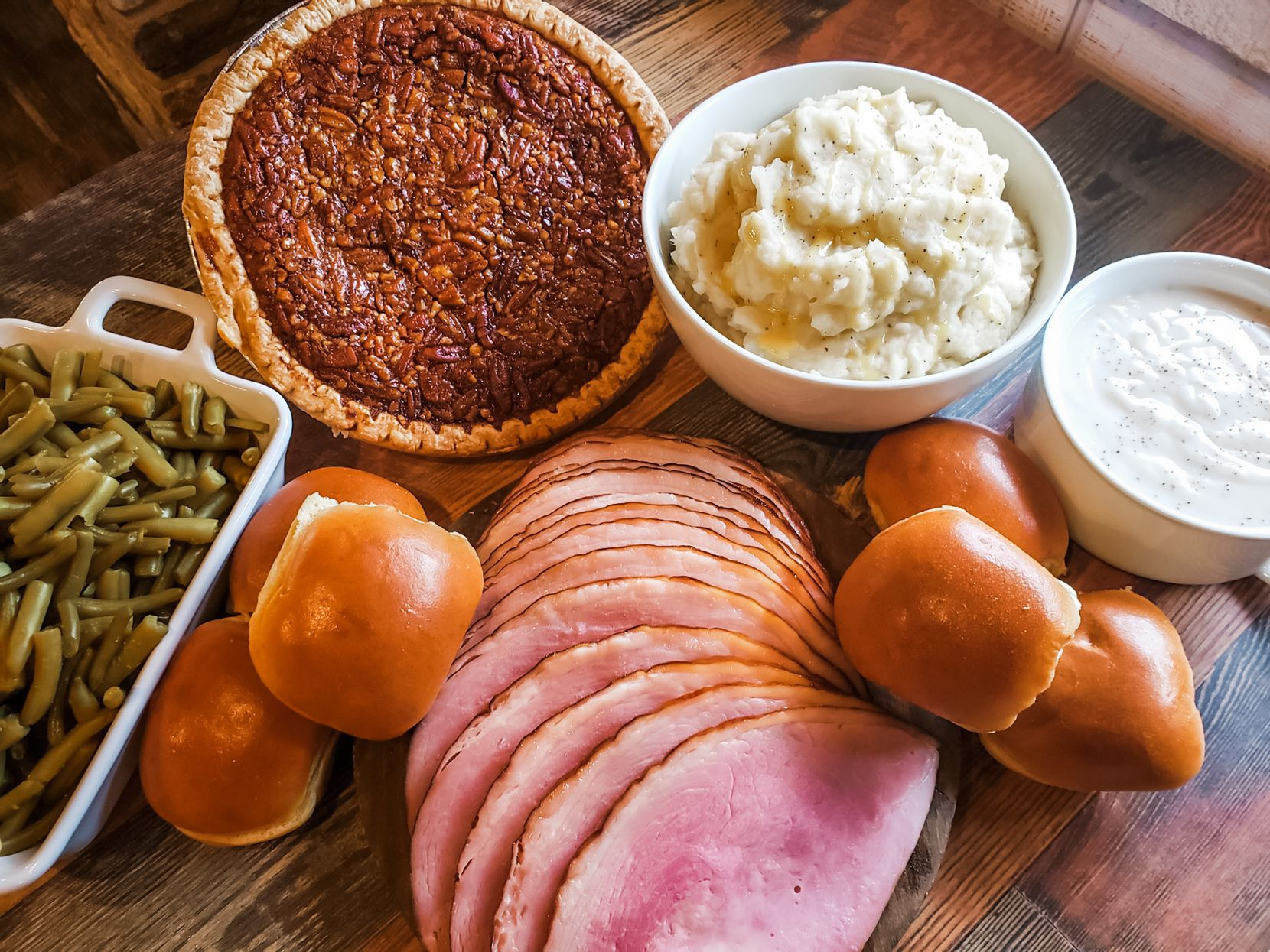 Soulman's Bar-B-Que offers a holiday meal featuring spiral slice ham, green beans, mashed potatoes, gravy, dinner rolls and pecan pie.