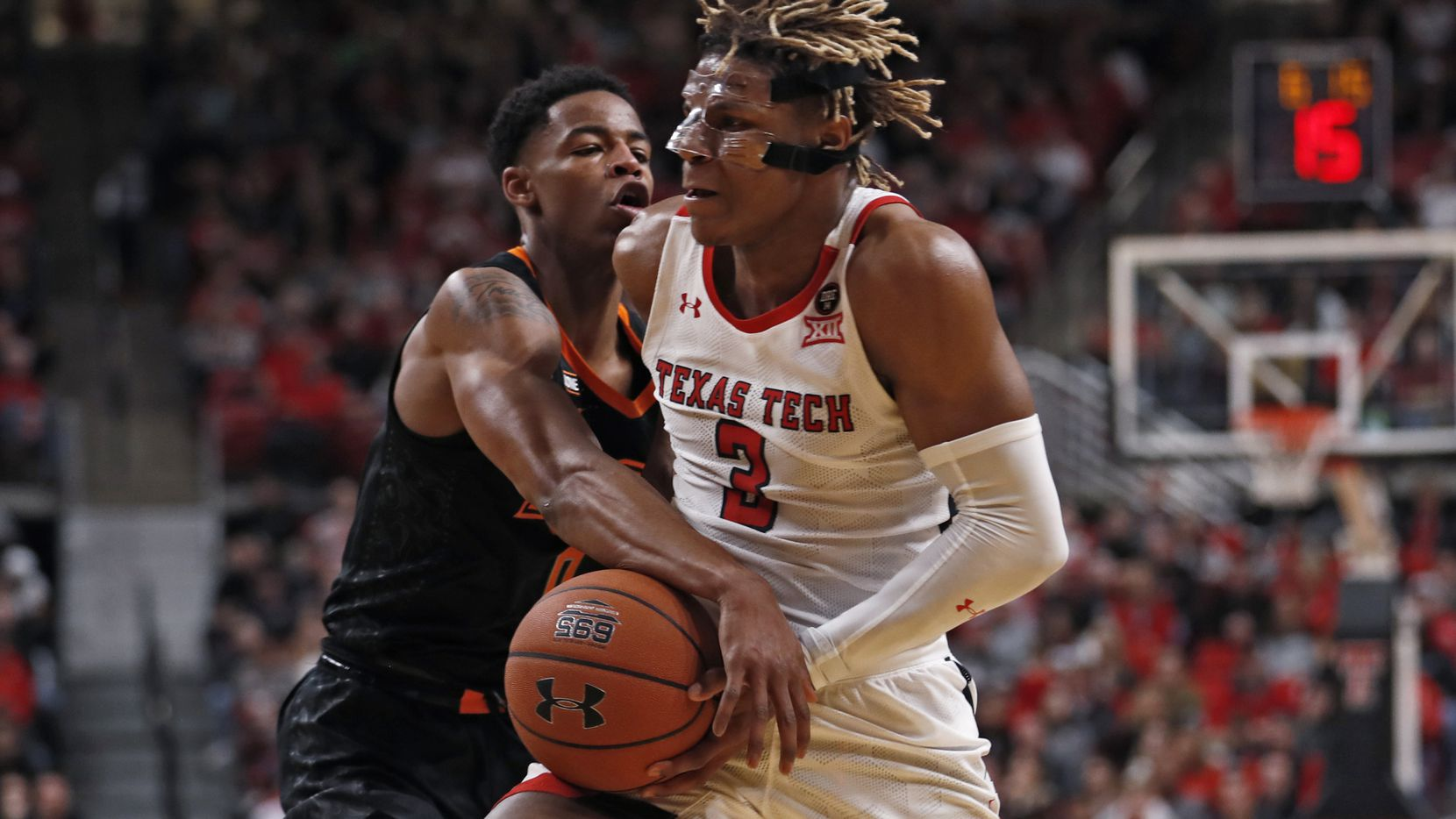 Oklahoma State's Avery Anderson III (0) tries to steal the ball away from Texas Tech's Jahmi'us Ramsey (3) during the first half of an NCAA college basketball game Saturday, Jan. 4, 2020, in Lubbock, Texas.