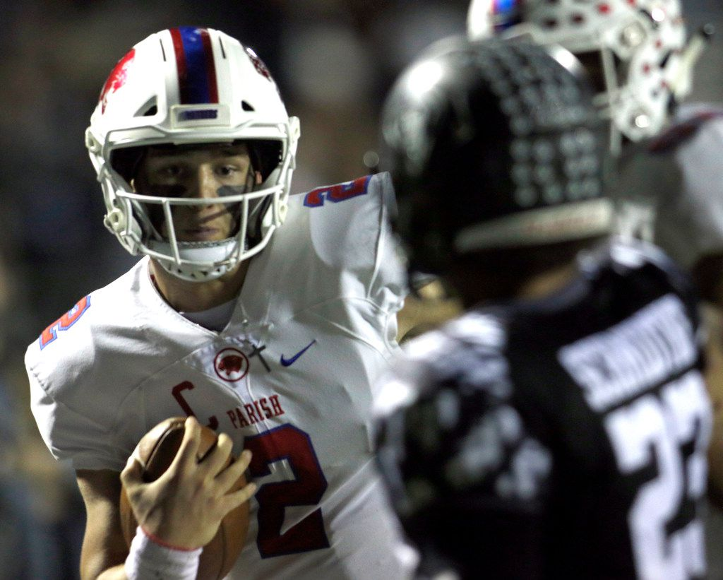 Parish Episcopal quarterback Preston Stone (2) negotiates the final few yards as Bishop Lynch defender Isaiah Schmidtke (23) moves in defensively enroute to a long rushing touchdown during first quarter action. The two teams played their TAPPS football game at Roffino  Stadium on the campus of Bishop Lynch High School in Dallas on October 18, 2019.