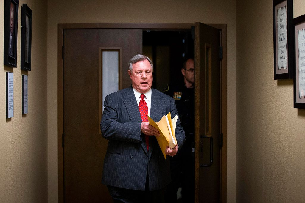 Tarrant County Republican Party spokesman Mike Snyder exits a meeting of Tarrant County Republican Party executive committee with the results of a vote to oust vice chair Dr. Shahid Shafi at Faith Creek Church Thursday, Jan. 10, 2019, in Richland Hills.