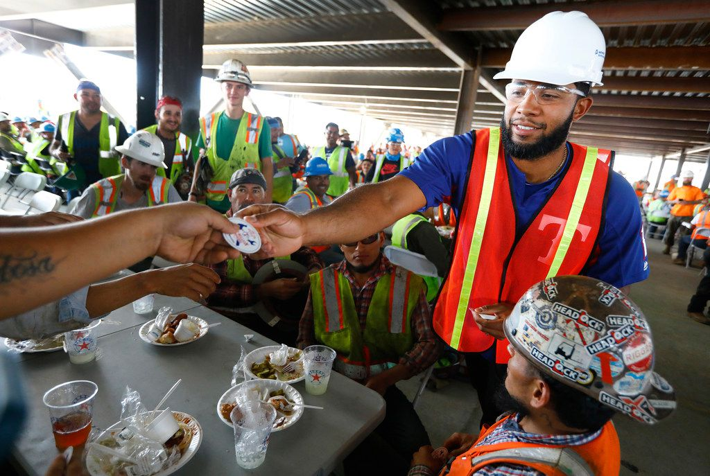 Texas Rangers shortstop Elvis Andrus hands out One Million Man Hours helmet stickers to construction workers at the new Globe Life Field under construction in Arlington, Texas, Tuesday, September 18, 2018. The Texas Rangers celebrated the One Million Man Hours by providing a barbecue lunch for its nearly 900 construction workers. Rangers baseball players joined manager Jeff Banister in handing out the stickers to mark the occasion. They also signed autographs and posed for photos.