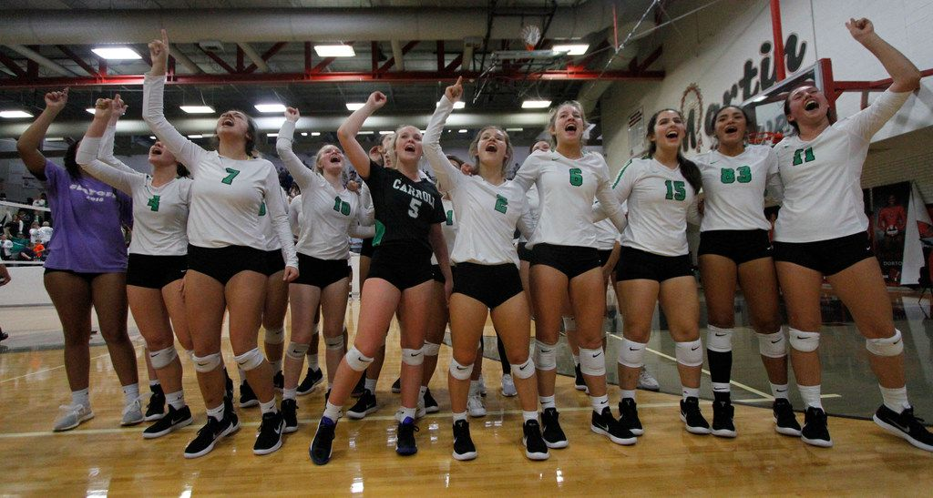 Members of the Southlake Carroll volleyball team revel in the moment after defeating Waxahachie in five sets to advance to the Class 6A Region I semifinals. (Steve Hamm/ Special Contributor)